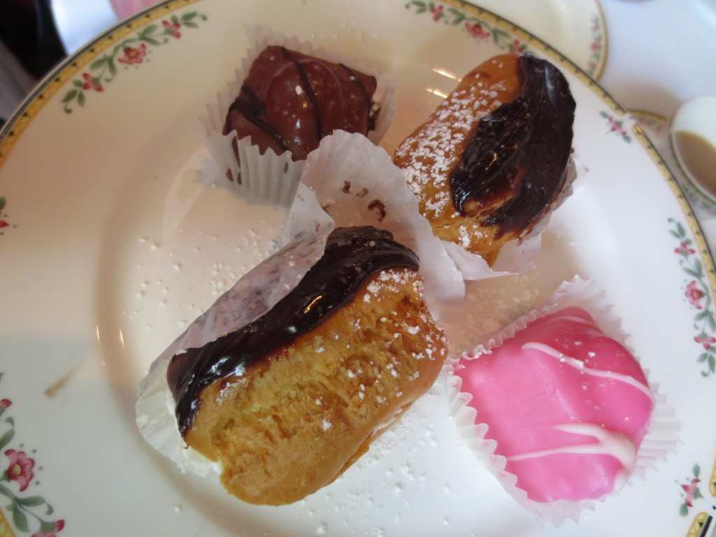 2 eclairs, a chocolate petit four, and a vanilla petit four